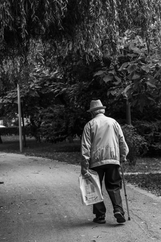 grayscale-back-view-photo-of-elderly-man-with-cane-walking-2586537.jpg